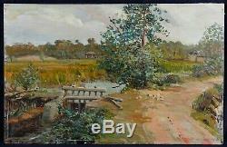 Paysage au pont Ancienne Huile sur panneau signée en bas à droite 37x57 cm